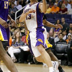 Phoneix Suns' Steve Nash drives against the Los Angeles Lakers during the second half of an NBA basketball game, Saturday, April 7, 2012, in Phoenix.