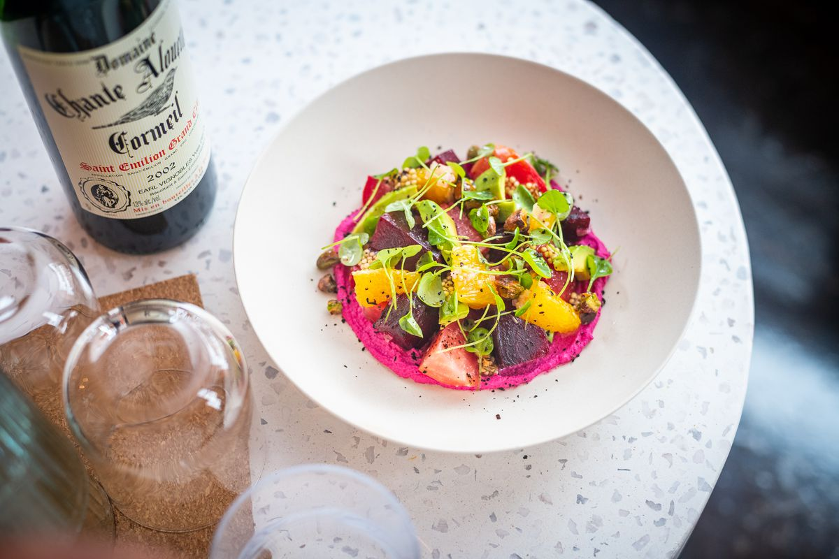 A roasted beet salad from Lulu's Winegarden includes a puree of beet, goat cheese, and yogurt with citrus, pickled mustard seeds, pistachios, and watercress