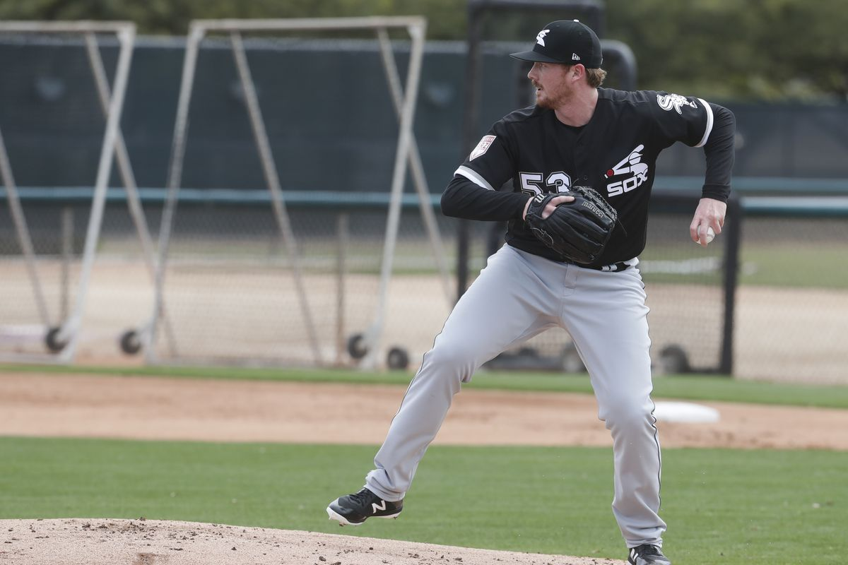 Caleb Frare throws during a spring training workout in Glendale, Ariz. (AP Photo/Morry Gash)