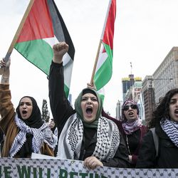 Hundreds march through the streets of downtown Chicago to protest the U.S. embassy in Israel move from Tel Aviv to Jerusalem, and violent bloodshed during protests on the Gaza border, Tuesday afternoon, May 15, 2018. The protest comes one day after Israeli soldiers shot and killed 59 Palestinians and wounded more than 1,300 in the mass protests. | Ashlee Rezin/Sun-Times