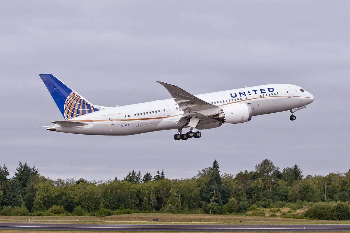 In this undated photo provided by Boeing Commercial Airplanes, the first Boeing 787 that will be used by United Airlines, is shown taking off.  U.S. travelers are going to be seeing a lot more of the 787, the ultra-lightweight jet that aims to reduce flie