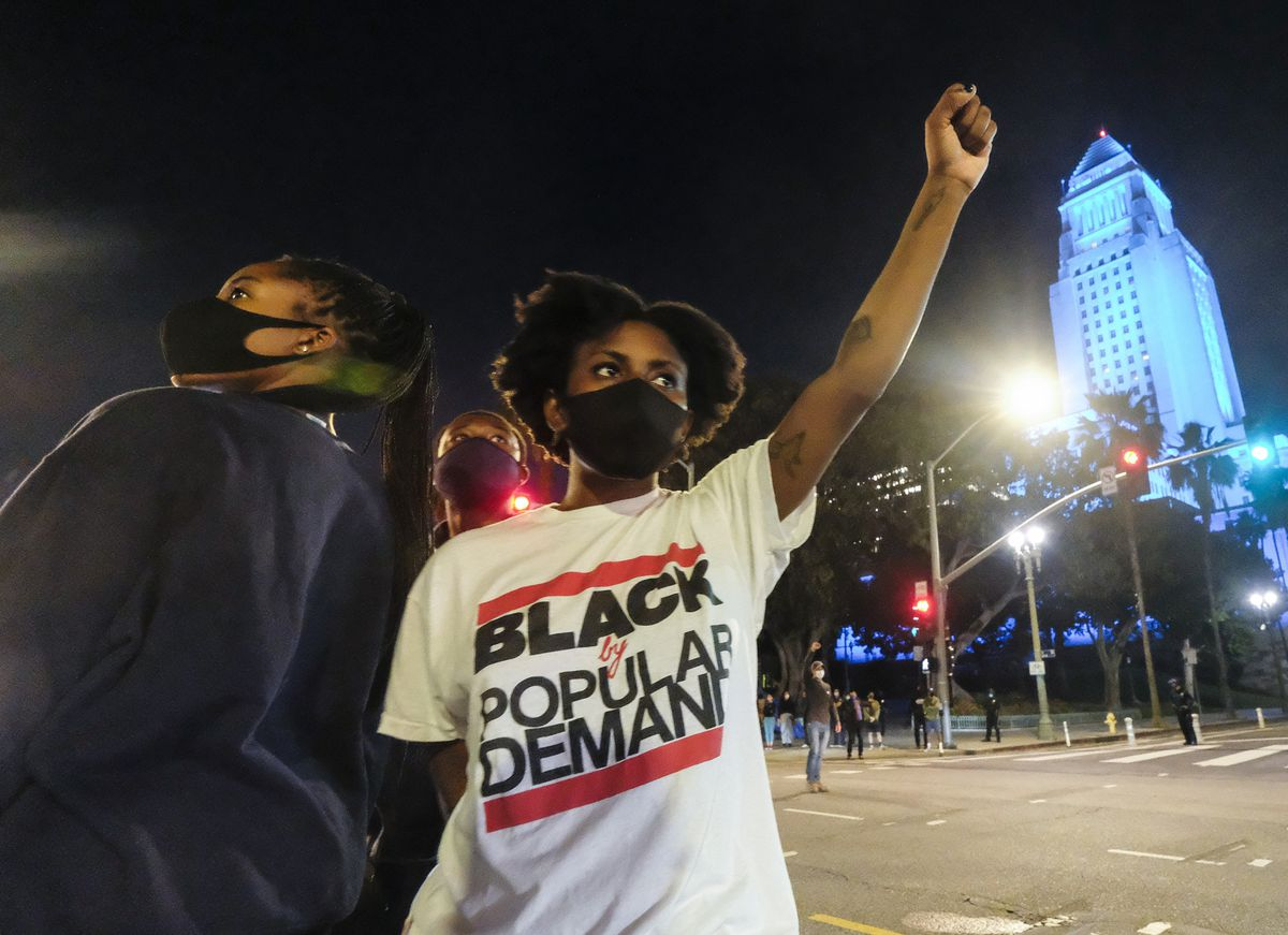 Demonstrators protest during a protest of the death of George Floyd, a black man who was in police custody in Minneapolis, in downtown Los Angeles, Wednesday, May 27, 2020. (AP Photo/Ringo H.W. Chiu)