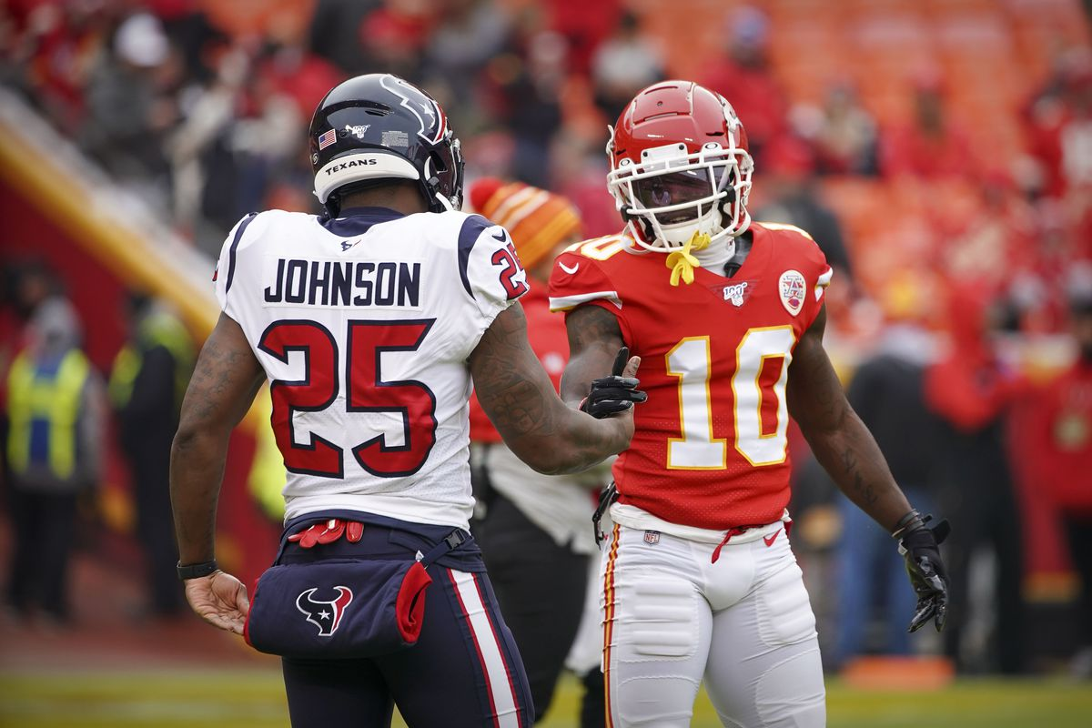 Houston Texans running back Duke Johnson greets Kansas City Chiefs wide receiver Tyreek Hill before the game between the Chiefs and the Texans in a AFC Divisional Round playoff football game at Arrowhead Stadium.
