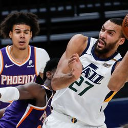 Utah Jazz center Rudy Gobert (27) is being fouled while making a layup attempt during an NBA preseason game at Vivint Smart Home Arena in Salt Lake City on Saturday, Dec. 12, 2020.