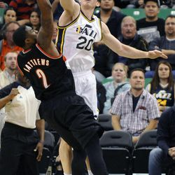 Utah Jazz small forward Gordon Hayward (20) is called for a foul while blocking the shot of Portland Trail Blazers shooting guard Wesley Matthews (2) in the second half of a game at the Energy Solutions Arena on Wednesday, October 16, 2013.