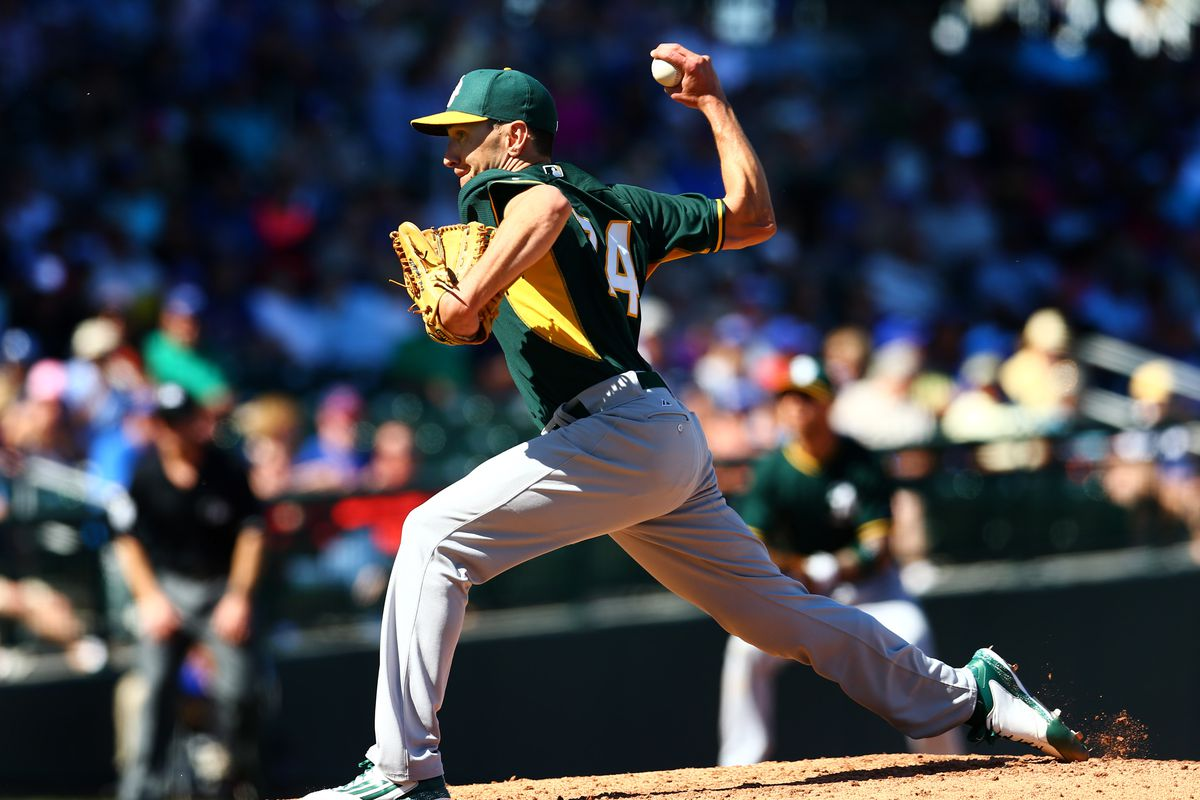 Pat Venditte, pitching right-handed for the Oakland Athletics.