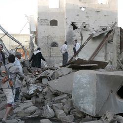 People inspect the damage of houses destroyed by Saudi-led airstrikes in Sanaa, Yemen, Friday, Jun. 9, 2017. Three siblings and their grandmother were killed early Friday after Saudi-led coalition forces dropped munitions on three houses in the Yemeni capital, the children's father said.