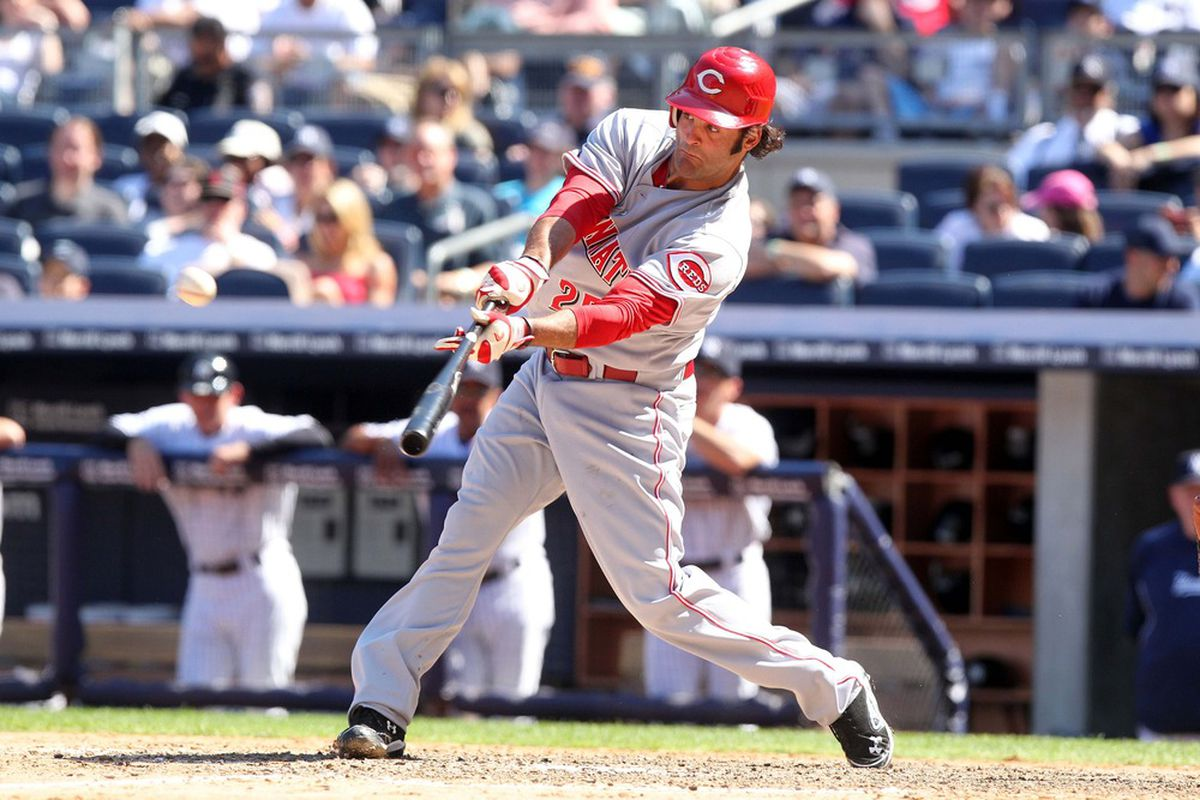 May 19, 2012; Bronx, NY, USA; Cincinnati Reds designated hitter Mike Costanzo hits a sacrifice fly during the eighth inning of a game against the New York Yankees at Yankee Stadium. Mandatory Credit: Brad Penner-US PRESSWIRE
