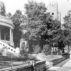 People stroll down South Temple in 1912. The Cathedral of the Madeleine can be seen in the background.