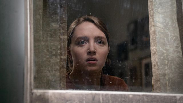 Kiera Allen looks fearfully out of a window in Hulu's Run
