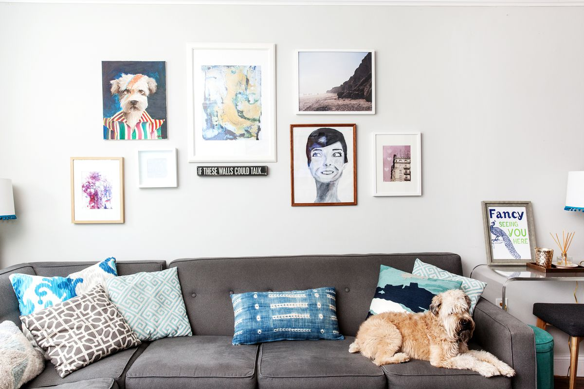 Ricki is the couple's Wheaton Terrier, whose favorite spot in the house is in front of the living room windows. The couch is from Raymour and Flanigan.