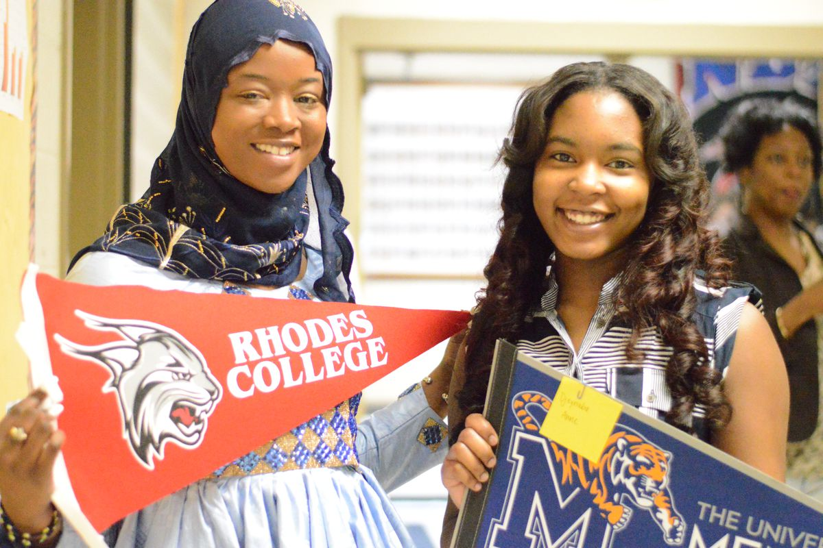 From left: Fatimata Deme and Djeynaba Anne proudly show off their college choices during Academic Signing Day at Whitehaven High School in Memphis.