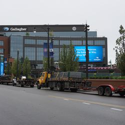 Trucks loaded with construction barricades, parked along Clark Street