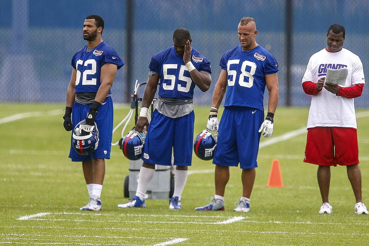 New York Giants linebackers Spencer Paysinger (52) , Keith Rivers (55) and Mark Herzlich (58) during OTAs Wednesday at the Timex Performance Center