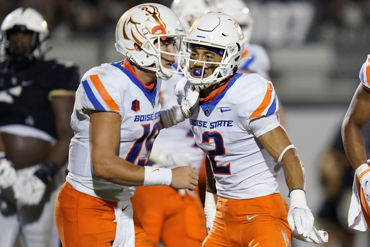 Boise State receiver Khalil Shakir (2) and QB Hank Bachmeier celebrate after a 7-yard touchdown pass against Central Florida.