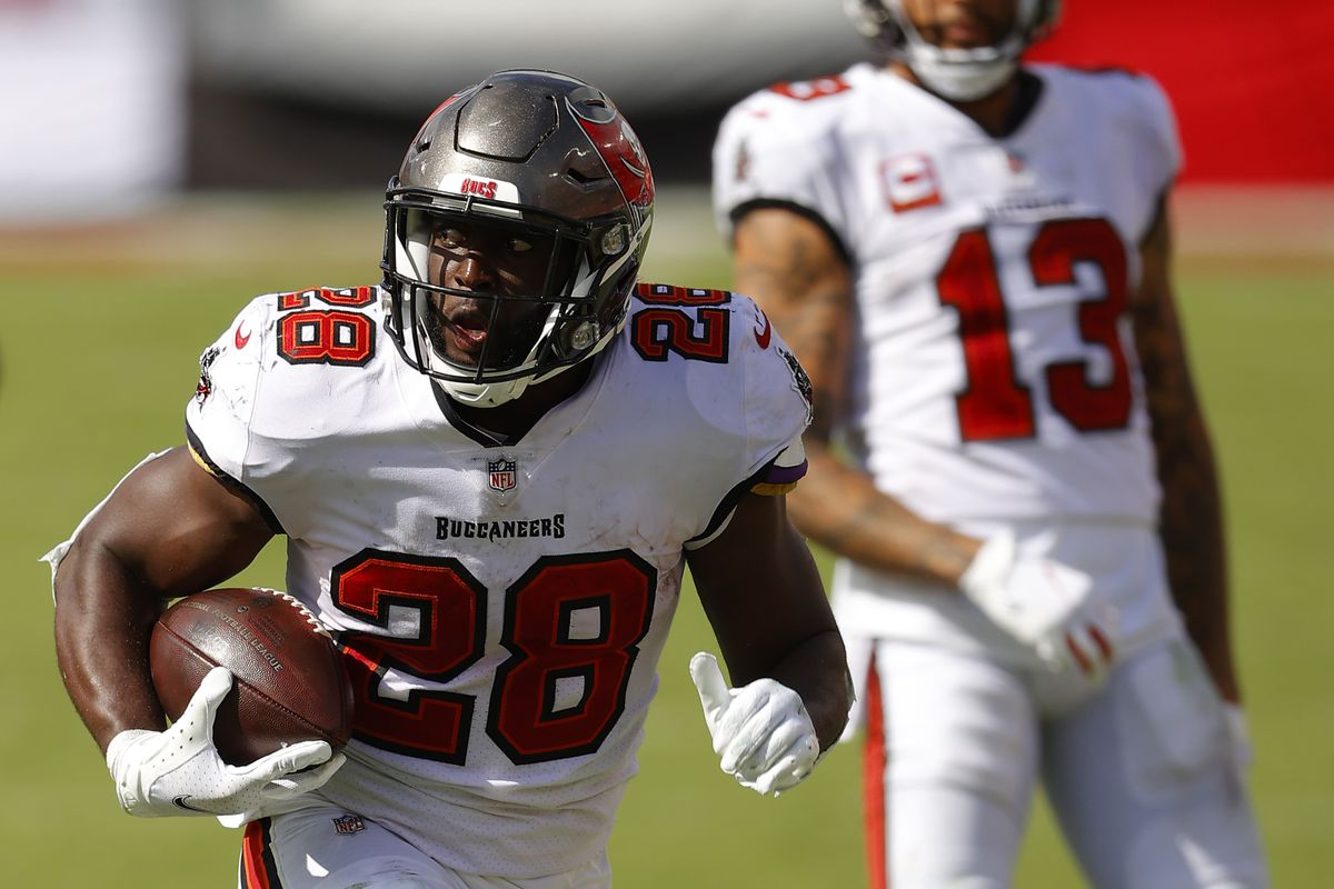 Leonard Fournette #28 of the Tampa Bay Buccaneers scores a 46-yard rushing touchdown during the fourth quarter against the Carolina Panthers at Raymond James Stadium on September 20, 2020 in Tampa, Florida.