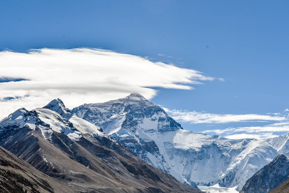 A distant view of Mt. Everest, showing surrounding peaks.