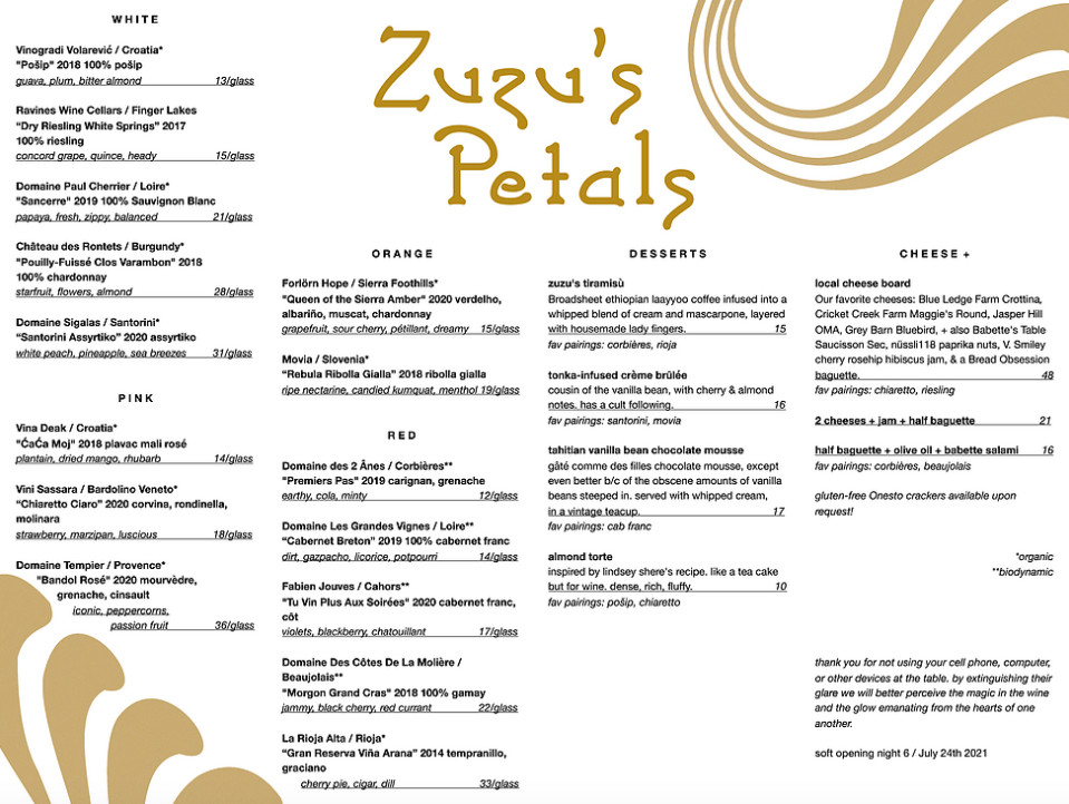 Menu for a restaurant named Zuzu's Petals, featuring wines, a cheese board, and desserts. Black text and a light brown logo on a white background.