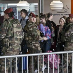 French soldiers patrol at Charles de Gaulle airport, in Roissy, north of Paris, Tuesday, March 22, 2016. Authorities are tightening security at airports and on the streets of European cities after attacks on the Brussels airport and subways system that killed at least 34 people and injured many others. Security has been beefed up in France, Austria, Poland and the Czech Republic.