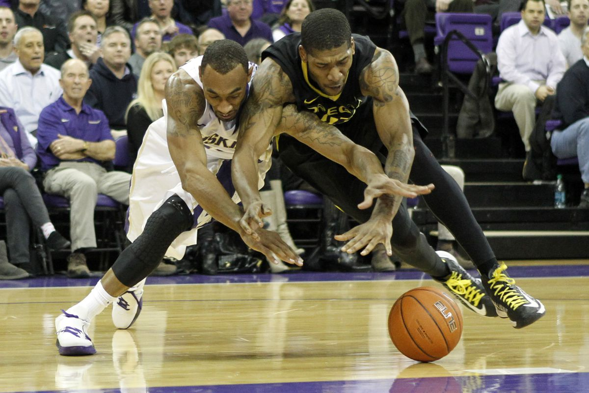 They fight for a loose ball, and Oregon probably got it.