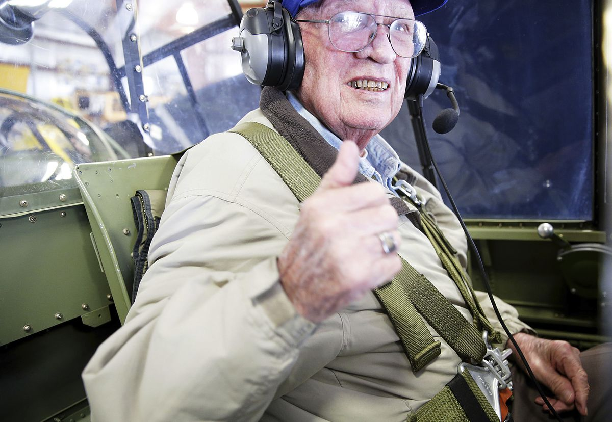 Jim Lair is strapped into Brad Deckert's TBM Avenger at the  Illinois Valley Regional Airport in Peru, Ill. During WWII, Lair, 90, usually rode below as the radio operator on the Avenger, which held three crew members. But this time, he opted for the gunn