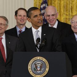 Surrounded by members of Congress and others, President Barack Obama speaks prior to signing the Omnibus Public Lands Management Act of 2009, Monday, March 30, 2009, in the East Room of the White House in Washington. From left are Senate Majority Leader Harry Reid of Nev., Sen. Ron Wyden, D-Ore,  the president, Sen. Robert Bennett , R-Utah, and Interior Secretary Ken Salazar.