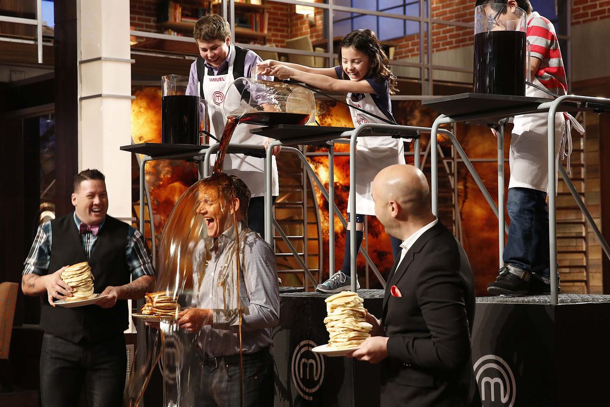 Gordon Ramsay (center) gets doused with syrup on MasterChef Junior. Yes, this is the kind of thing that happens on this show.