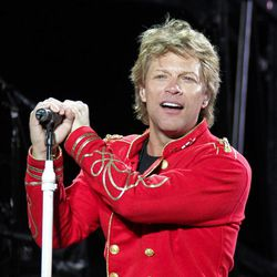 """FILE - This July 27, 2011 file photo shows singer Jon Bon Jovi performing during Bon Jovi's """"Open Air Tour"""" show at Estadio Olympico, in Barcelona, Spain. A New Jersey man will face five years in prison after pleading guilty to a string of burglaries at the Jersey shore, including the home of rocker Jon Bon Jovi. Nicholas Tracy of Beachwood pleaded guilty Tuesday to three counts of theft and burglary from a spree that netted him more than $300,000 worth of jewelry and personal items from the homes. The thefts took place in March and April 2011 along the Middletown Township road where Bon Jovi lives."""