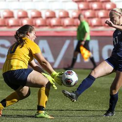 Bonneville's keeper Abree Beardall (00) blocks a shot from Skyline's Ali Swensen to keep the game alive in the final seconds of the second half of the 5A girls state championship at Rio Tinto Stadium in Sandy on Friday, Oct. 25, 2019. Skyline defeated Bonneville in overtime 2-1 to take home the state title.