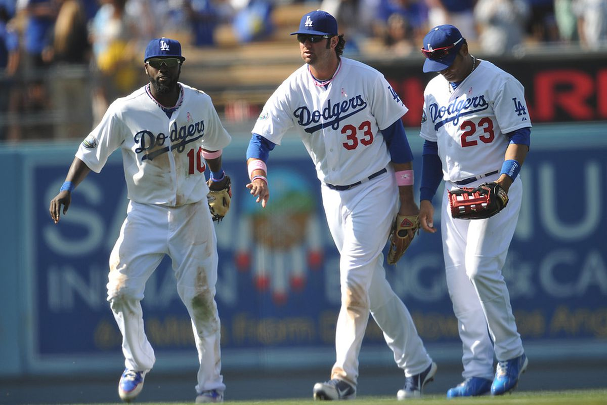 Just like the Dodgers drew it up: outfielders Tony Gwynn Jr., Scott Van Slyke, and Bobby Abreu celebrate a win on Sunday, the team's fifth win in six games.