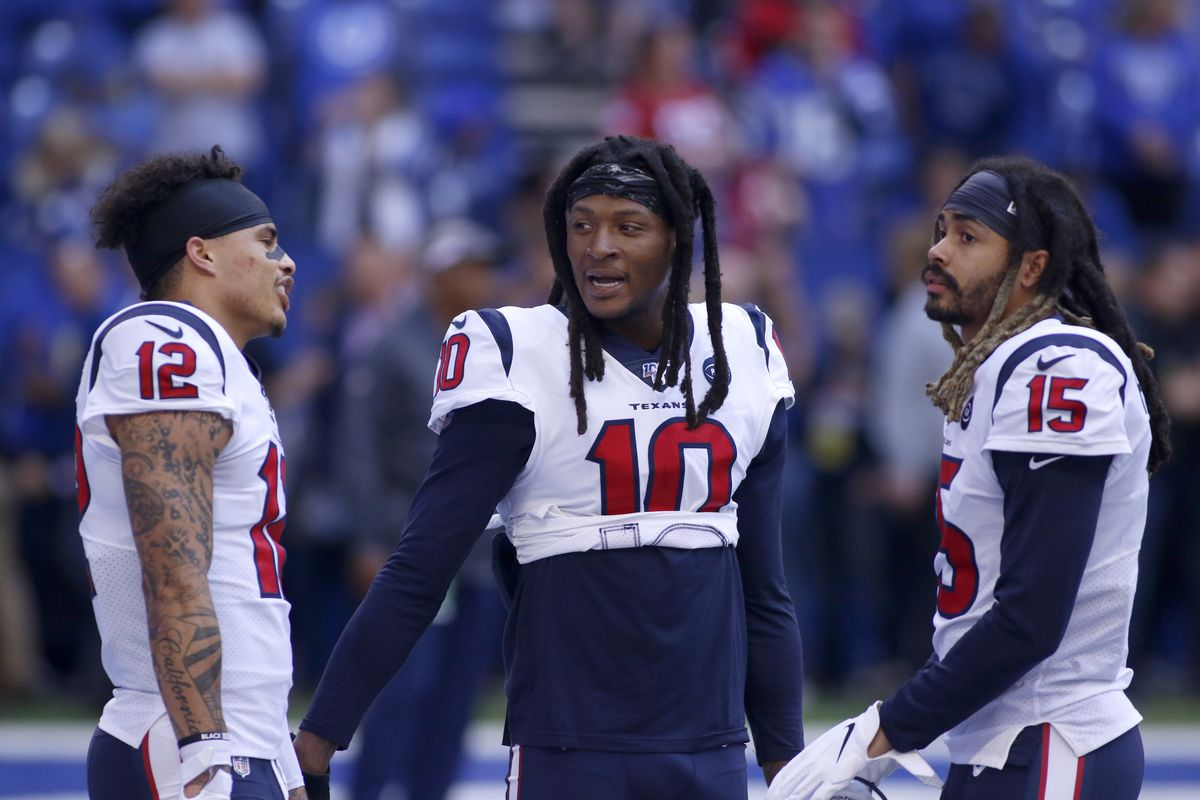 Kenny Stills talks with DeAndre Hopkins and Will Fuller of the Houston Texans before the game against the Indianapolis Colts at Lucas Oil Stadium on October 20, 2019 in Indianapolis, Indiana.