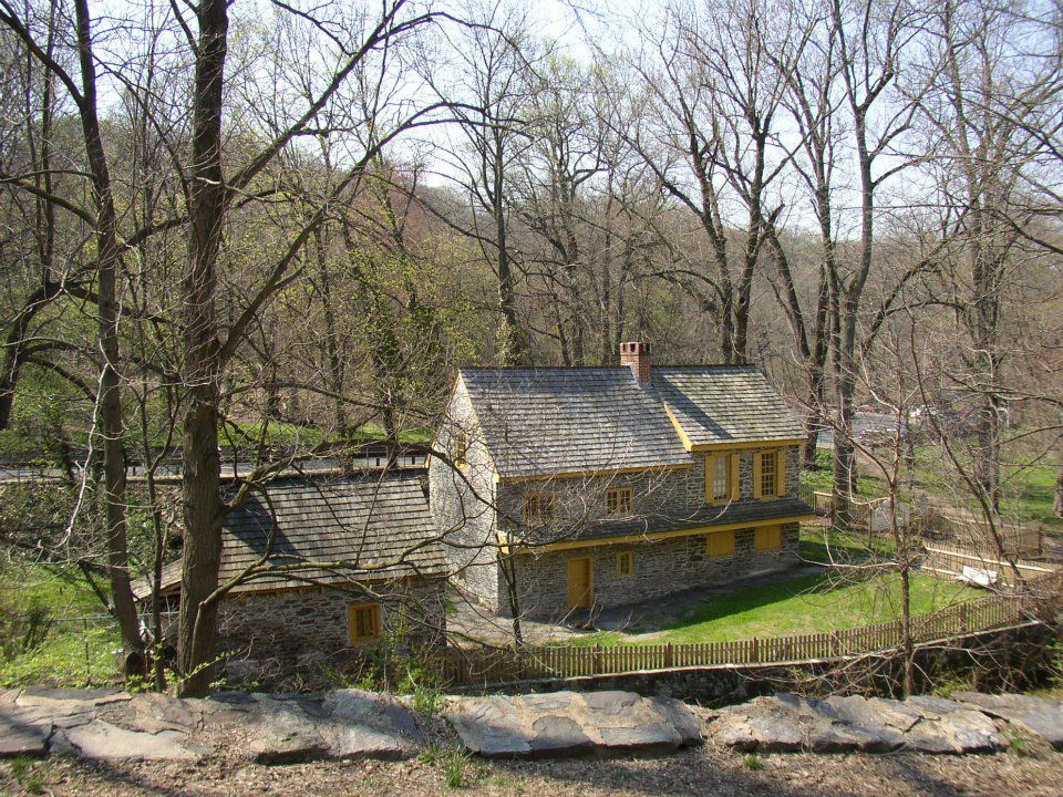 An aerial view of the Rittenhouse Homestead. The exterior is stone and there is a sloped roof.