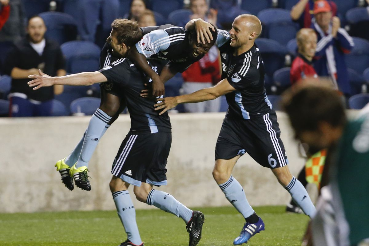 Mike Magee hoists Patrick Nyarko on his shoulder and carries him around the Toyota Park pitch to celebrate their connection on Magee's second goal of the night in Tuesday's US Open Cup 5th-round game.