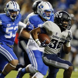 Joe Hill (32) of the Utah State Aggies runs the ball during NCAA football in Provo, Friday, Oct. 3, 2014.
