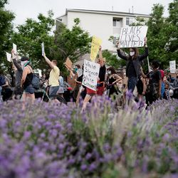 Protesters march along 300 South in downtown Salt Lake City on Saturday, June 13, 2020. The day's demonstrations were the latest in ongoing protests against racism and police brutality that have followed the killing of George Floyd in Minneapolis.