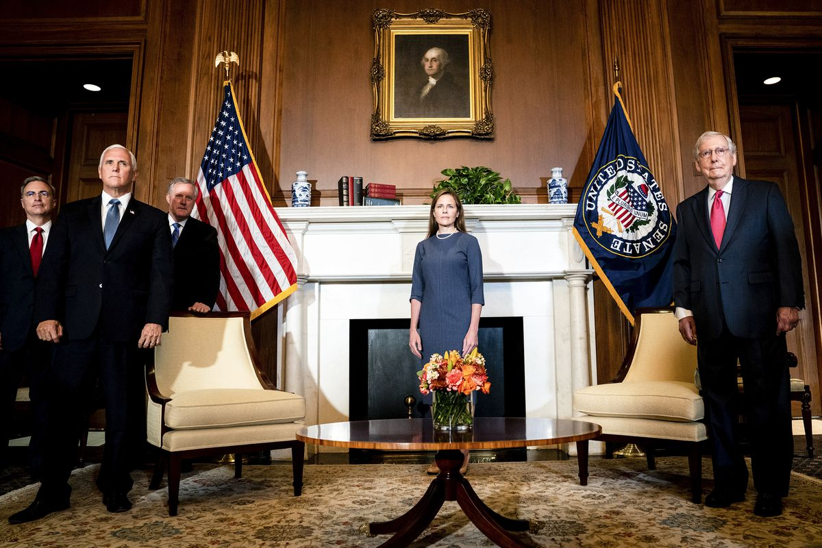 A photo of Amy Coney Barrett, Vice President Mike Pence, and Senate Majority Leader Mitch McConnell