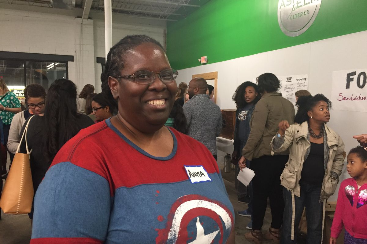 Anita Saunders poses for a photo after telling her story at the Teacher Story Slam last month.