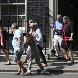 """Victims, volunteers and community leaders from the Grenfell Tower fire leave 10 Downing Street following a meeting with British Prime Minister Theresa May, after a fire engulfed the 24-storey building, in London, Saturday June 17, 2017. The meeting comes a day after May was heckled during a visit to the west London neighborhood where Wednesday""""™s inferno took place. At least 30 people have been killed, hundreds of others have been left homeless and dozens of others are missing."""