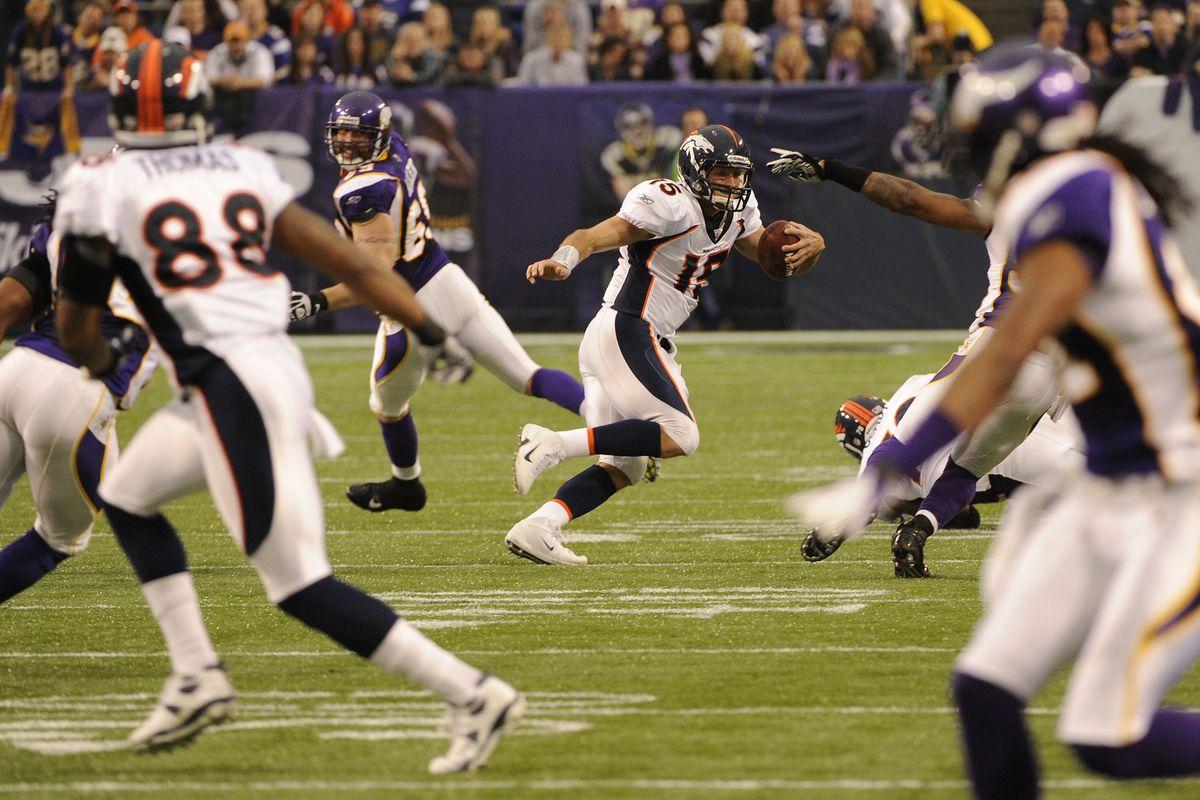 Denver Broncos quarterback Tim Tebow (15) kept the defense off balance as the Minnesota Vikings play home against the Denver Broncos at Mall of America Field in Minneapolis, MN, Sunday, December 4, 2011. Joe Amon, The Denver Post
