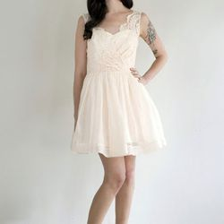 """Don't miss this Chantilly lace dress crafted by local Mission district designer, <a href=""""http://elizabethdye.com/"""">Elizabeth Dye</a>. <a href=""""http://elizabethdye.com/collections/"""">Notorious Dress</a>, price upon request. Duchess Clothier & Elizabeth Rye"""