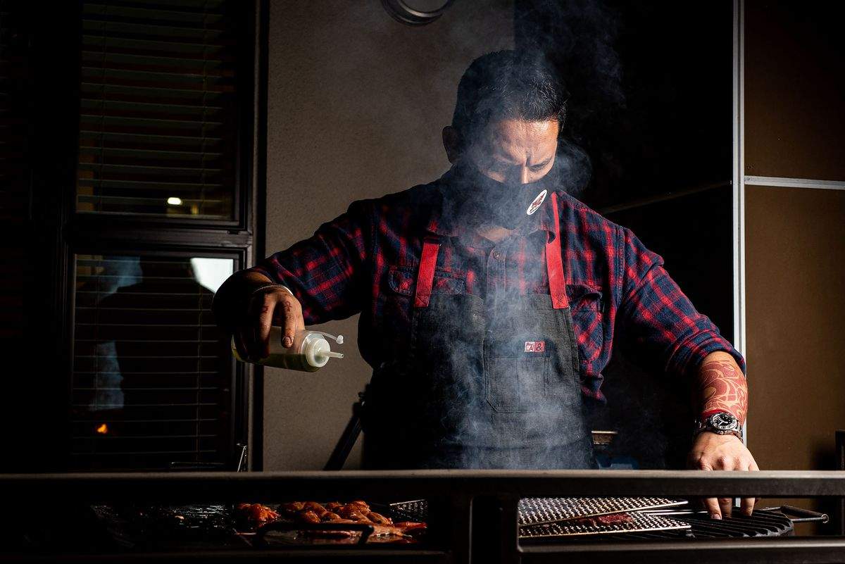 Hugo Bolaños of Búho Rouge behind the grill.