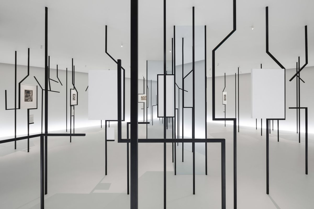 White gallery space with black frames