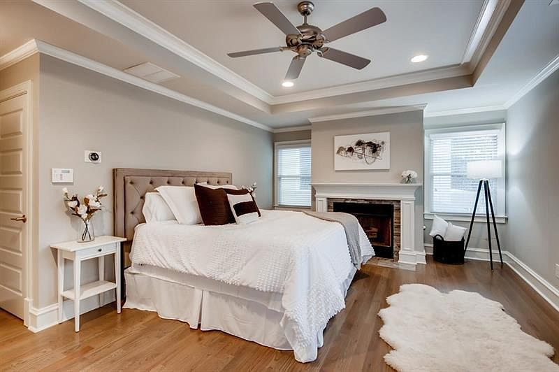 A gray and white master bedroom.