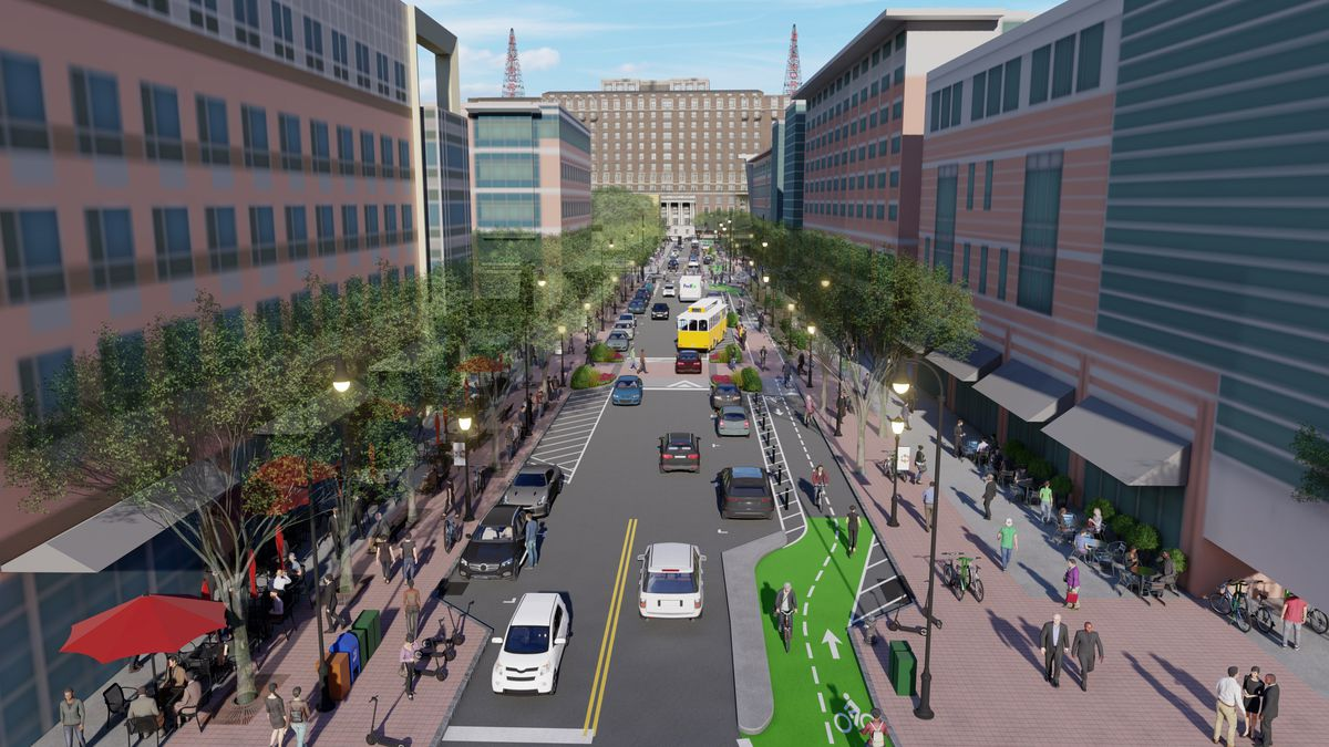 A rendering shows a street with one car lane in each direction, flanked by a protected two-way bike path and wide sidewalks.