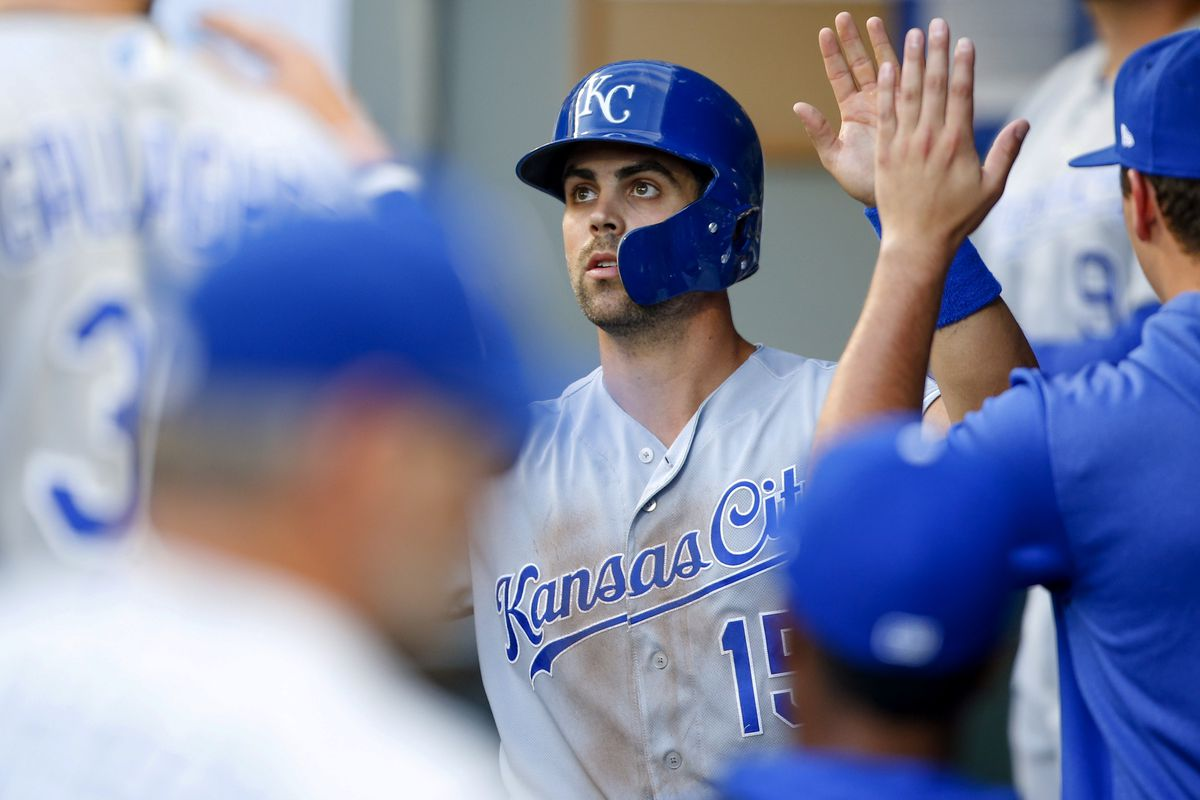 Kansas City Royals first baseman Whit Merrifield (15) is greeted in the dugout after scoring a run against the Seattle Mariners during the first inning at T-Mobile Park. Mandatory Credit: Joe Nicholson