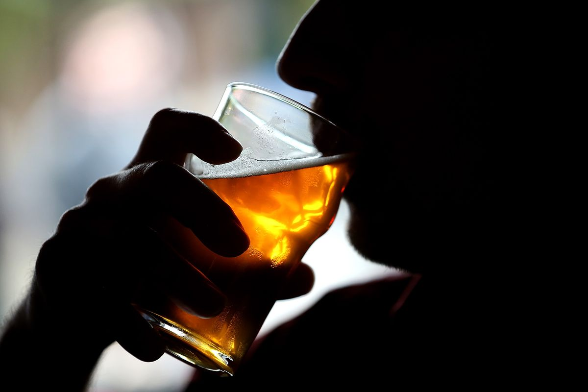 A man drinks beer.