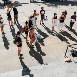 University of Utah students gather in front of the Administration Building during a protest on the University of Utah campus in Salt Lake City on Thursday, Aug. 6, 2020. A small group of demonstrators gathered to protest the handling of the Lauren McCluskey case amid recent reports that a police officer showed explicit photos of the slain student to fellow officers.