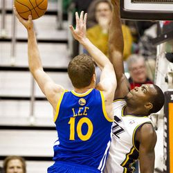 Warriors forward David Lee (10) shoots over Jazz forward Paul Millsap (24) during the first half of the NBA basketball game between the Utah Jazz and the Golden State Warriors at Energy Solutions Arena, Wednesday, Dec. 26, 2012.