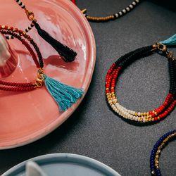Tribal bead bracelets with tassels, $25-$45