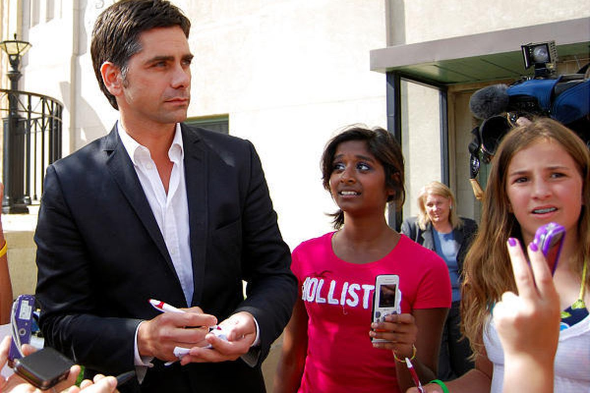 Actor John Stamos meets with fans outside of the federal building in Marquette, Mich., on July 13, 2010.